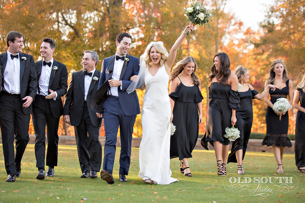 Groom in a navy tux, guys in black