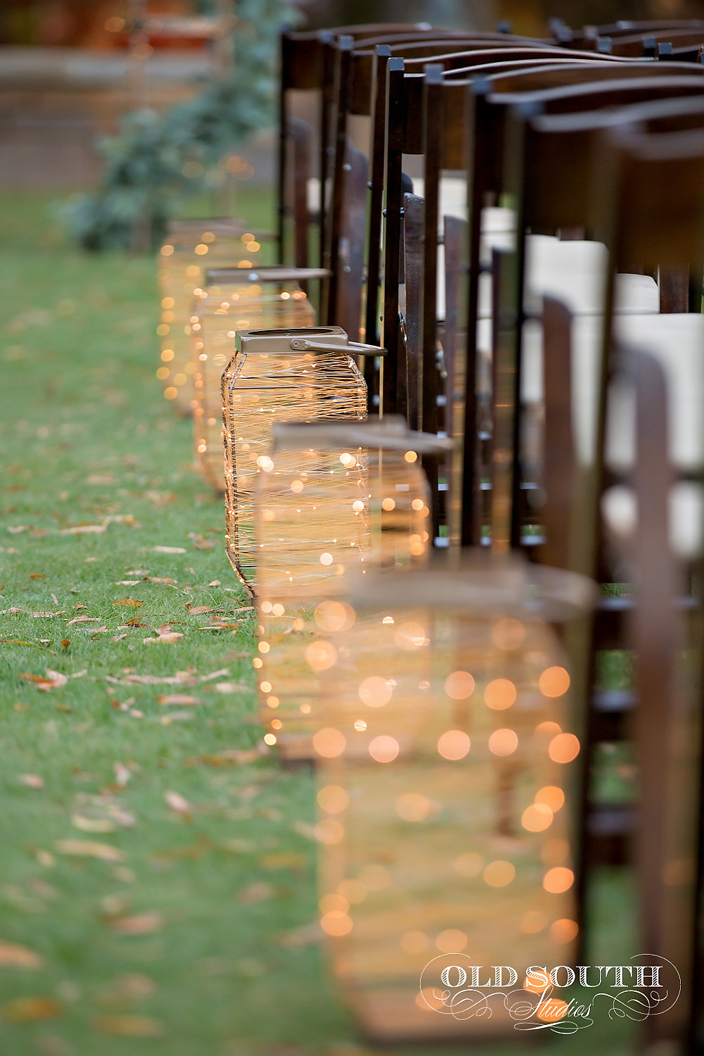 Magnificent Moments Weddings ceremony setup with lanterns