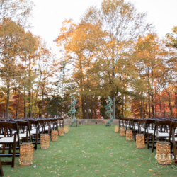 Magnificent Moments Weddings ceremony setup with lanterns and greenery runners