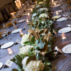 head table with greenery runner by the Flower Diva