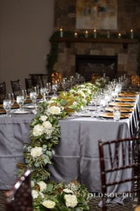 Amazing king table with stunning greenery garland for Charlotte Wedding reception