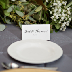 Place cards at the place setting for a Magnificent Moments Weddings wedding