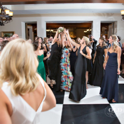 ladies trying to catch the bouquet toss