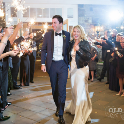 Magnificent Moments Weddings sparkler exit at the Ballantyne Country Club