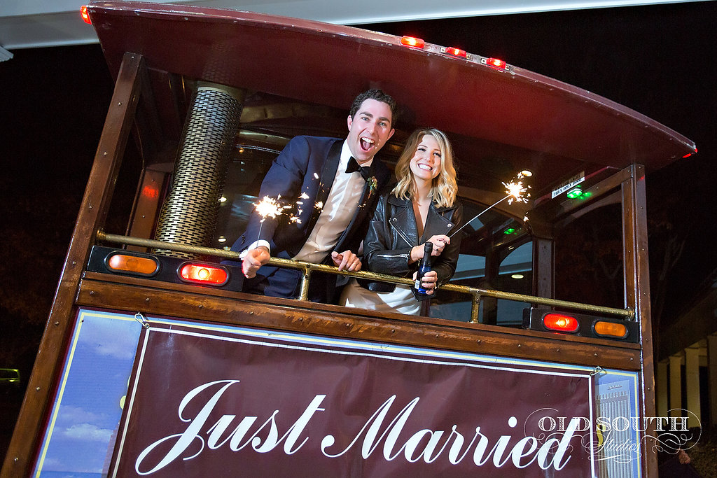Bride and groom riding off in the Trolley