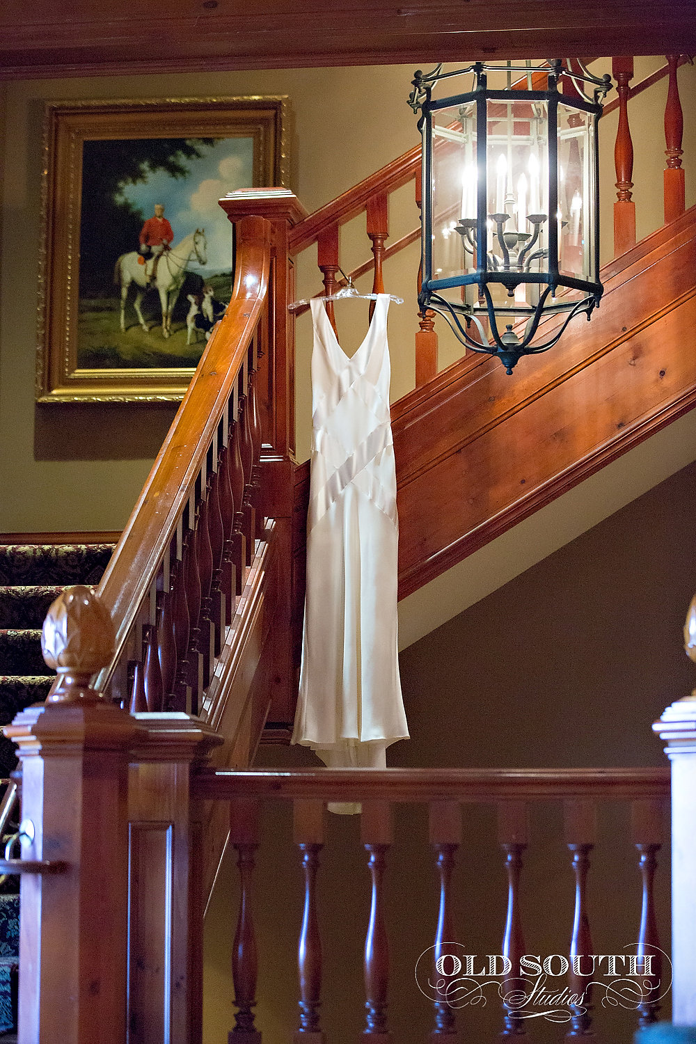 bride's dress hanging on a staircase