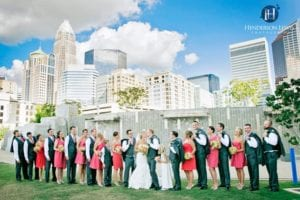 Uptown Charlotte wedding bridal party pictures in Romare Bearden Park beautiful city backdrop for a urban wedding