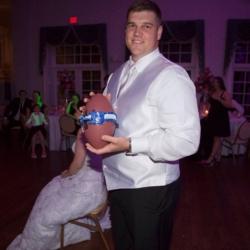 groom throwing the Duke ribbon garter on a football