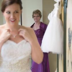 bride adjusting her necklace