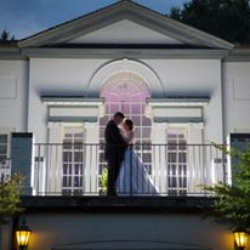 Bride and groom posing on the balcony of the Danville Golf Club in Virginia