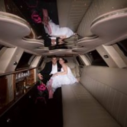 bride and groom riding in the limo