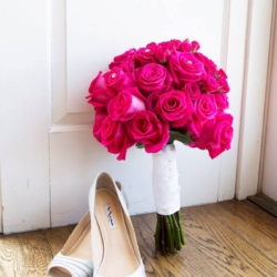 pink roses bouquet with wedding shoes