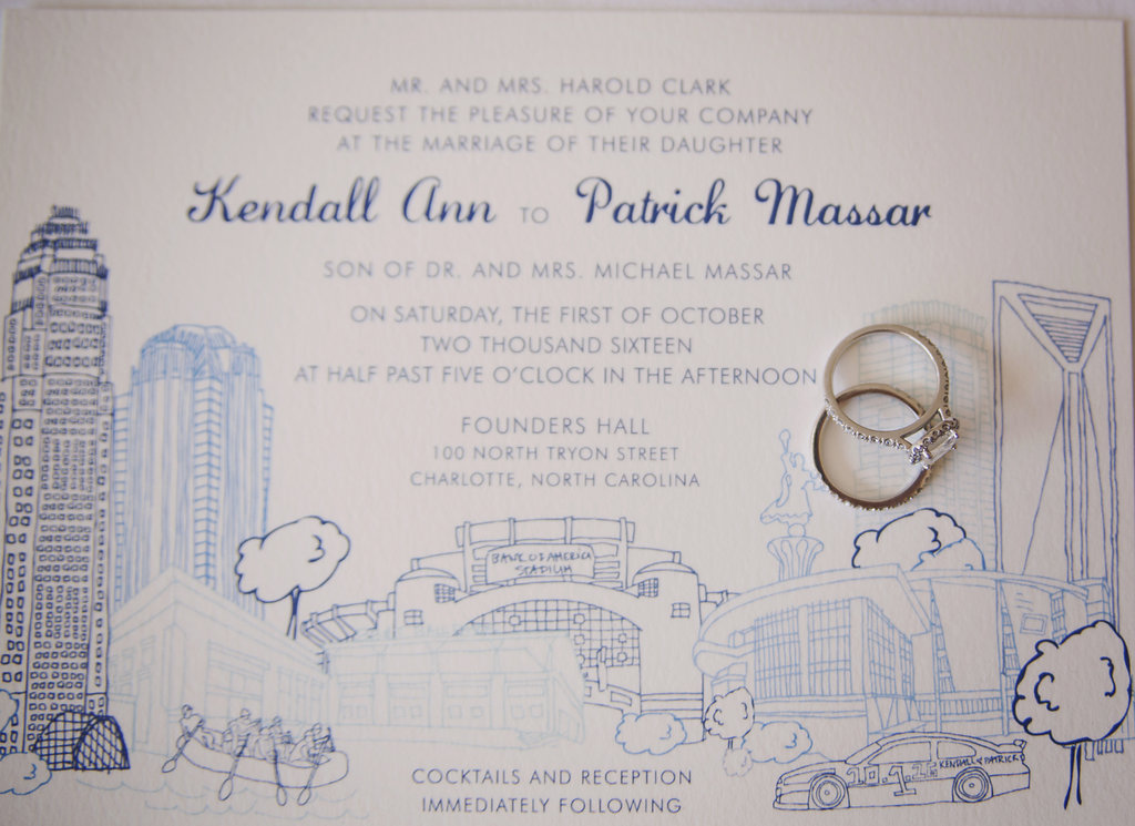 Invitation with Charlotte skyline and wedding rings by Viri Lovely Designs.