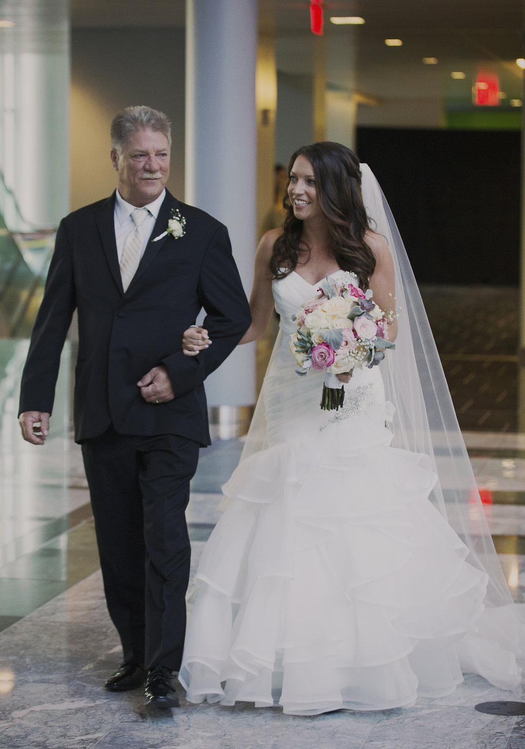 Bride and father walking down the aisle during a beautiful wedding ceremony at Founders Hall.