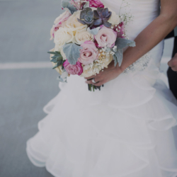 Bridal portrait with roses and succulents.
