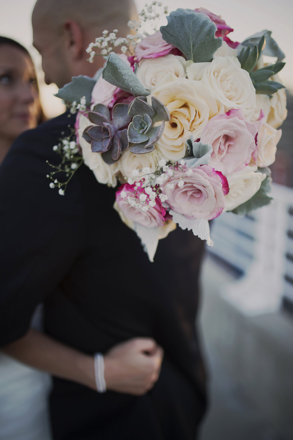 Gorgeous bouquet with succulents done by Magnificent Moments Weddings.