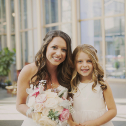 bride and her flower girl smiling