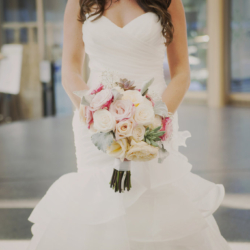 bridal bouquet of roses and dusty miller