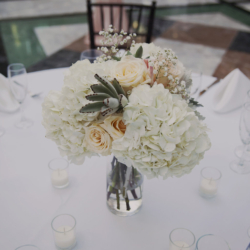 wedding centerpiece with hydrangeas and roses