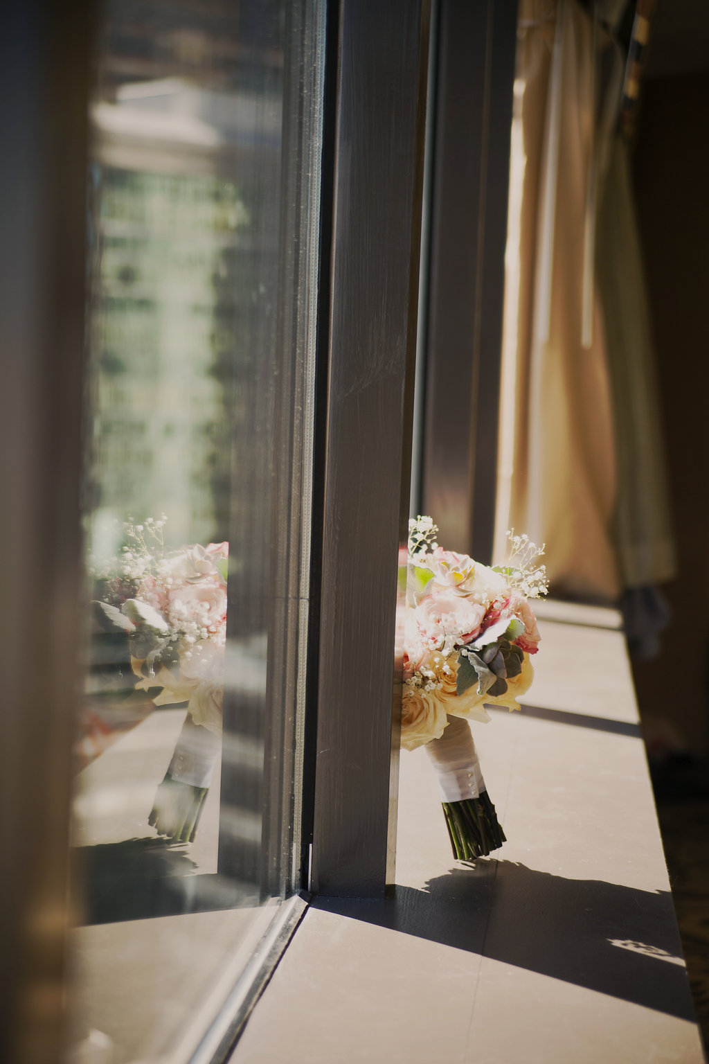 bridal bouquet on the ledge in a suite at the Omni Hotel in Charlotte North Carolina