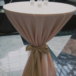 Cocktail table with blush pink linen.