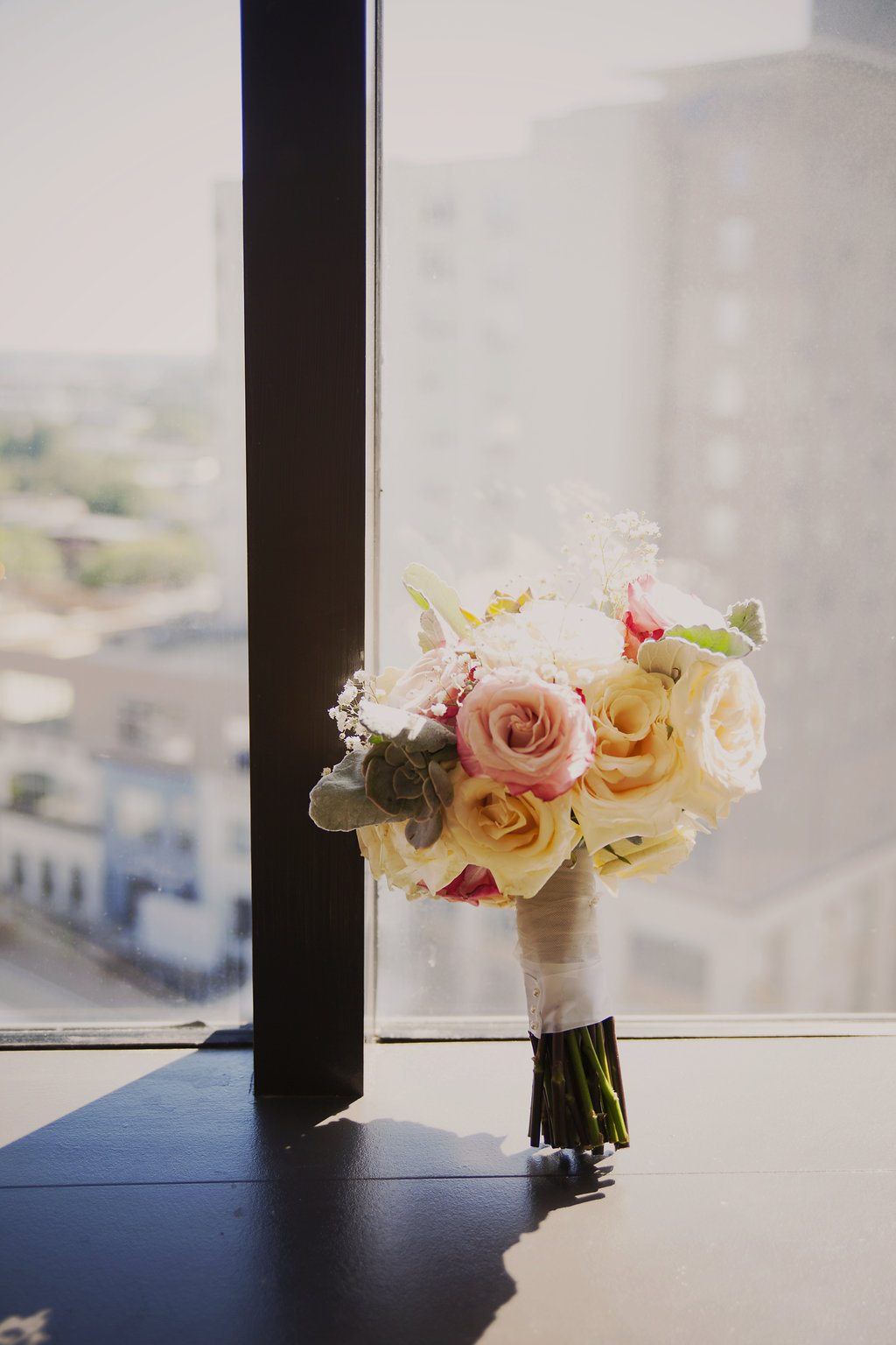 bridal bouquet in the window of the Omni hotel in Charlotte