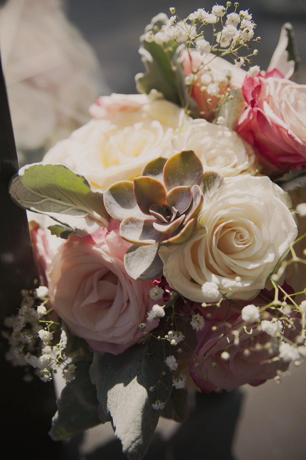 bridal bouquet with succulents and garden roses