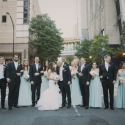 Wedding party in the street photo.