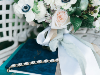 Beautiful bouquet with anemones and the vow book with silk ribbons.