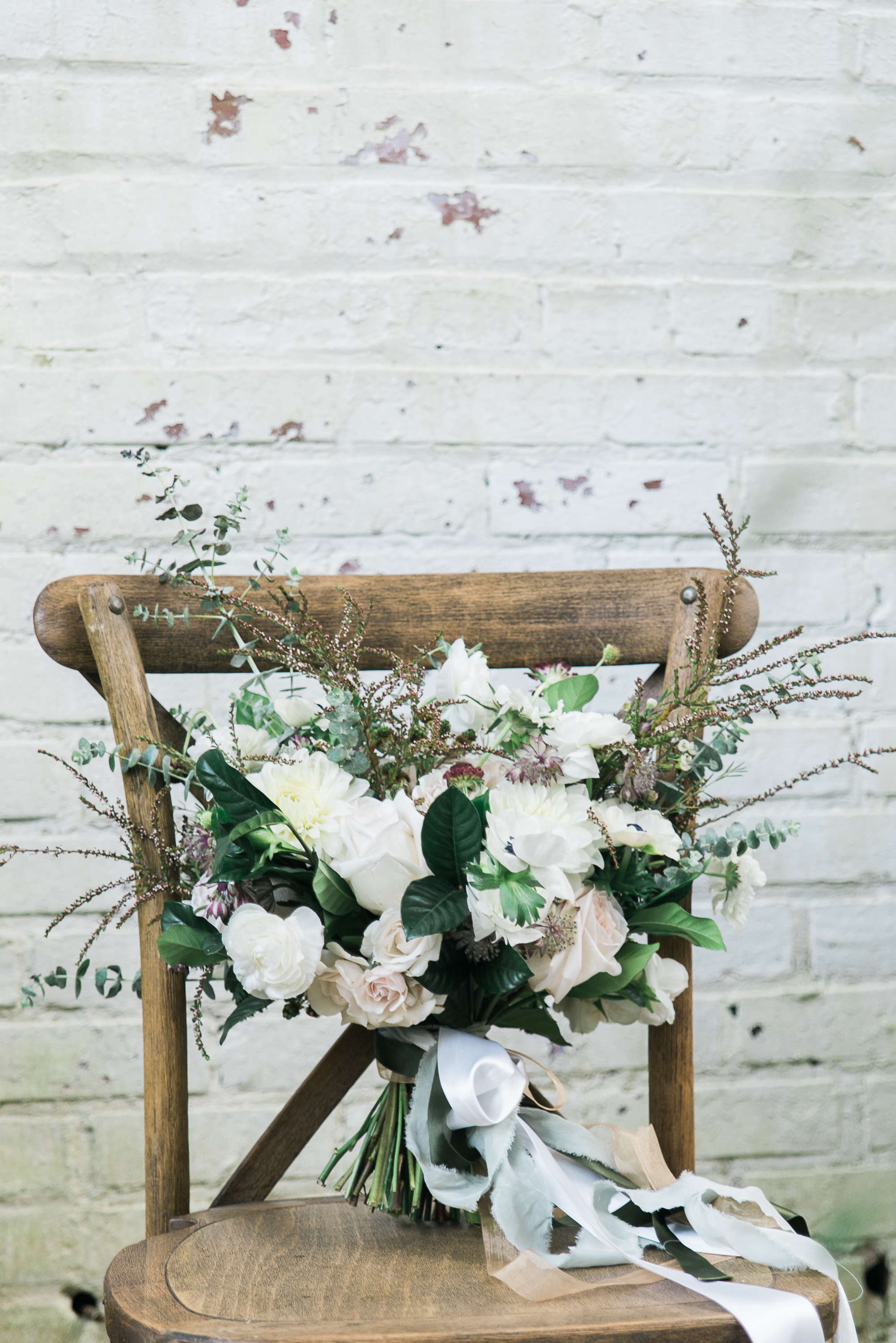 Beautiful bouquet by What's Up Butter Cup in a Party Reflections Tuscan Chair
