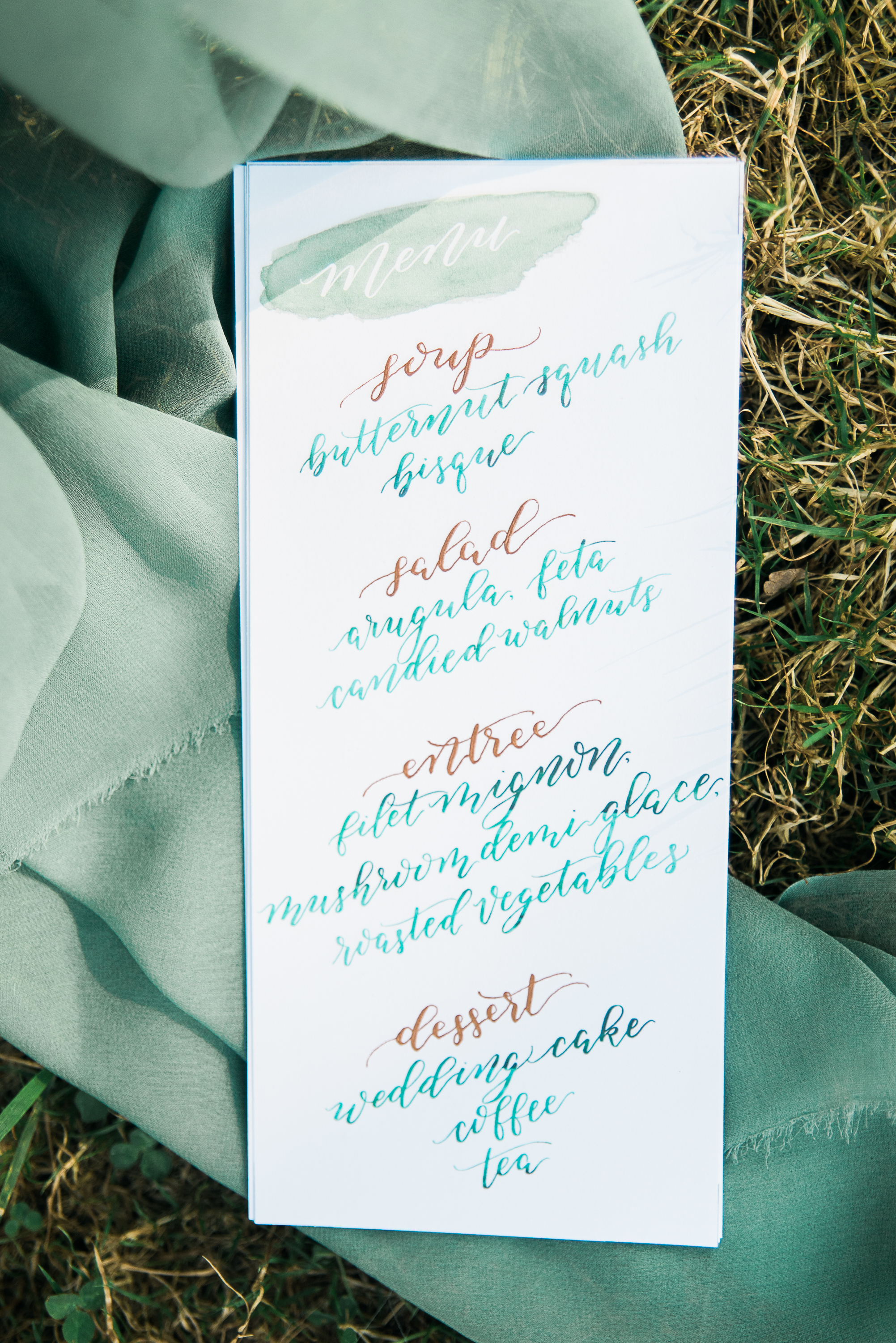 Copper and green calligraphy wedding menu.