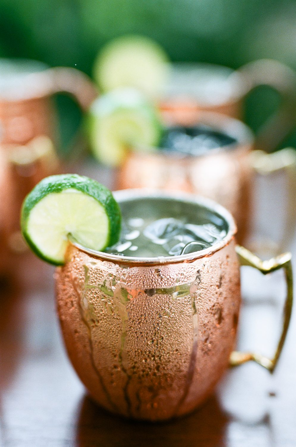 Frosted moscow mule wedding signature drink in copper mug with lime slice at the Ivy Place in Lancaster South Carolina