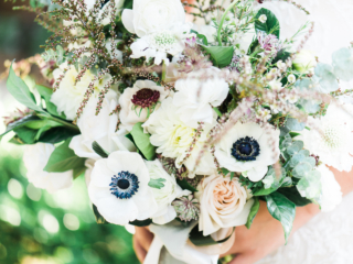 Gorgeous bouquet with anemones and pops of burgundy for the tiniest addition of color.