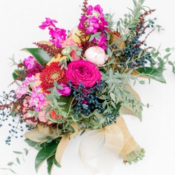 Stunning bridal bouquet created by Flower Diva has lush greens and pops of colors