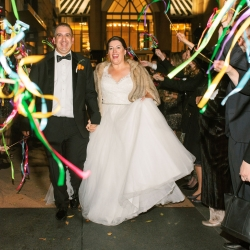 Bride and groom are all smiles as they leave their uptown wedding reception at Foundation for the Carolinas