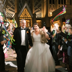 Bride and groom exit through a sea of ribbon wands during their fall wedding at Foundation for the Carolinas