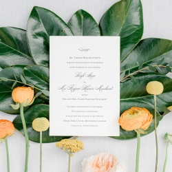 Sunshower Photography uses the lush florals from Flower Diva to show off the invitation for a fall wedding in Charlotte, North Carolina