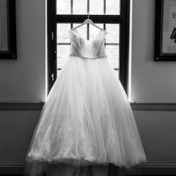 Sunshower Photography captures the details of a bridal gown for a fall wedding at Foundation for the Carolinas