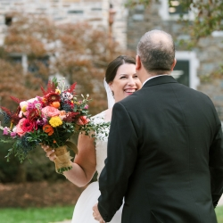 Bride is all smiles after her first look with her groom captured by Sunshower Photography