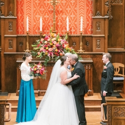 Sunshower Photography captures the kiss at the end of a fall wedding ceremony at Myers Park United Methodist Church