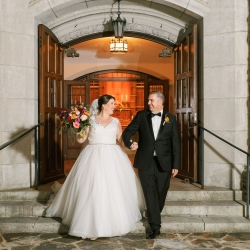 Bride and groom exit Myers Park United Methodist Church after exchanging vows during their wedding ceremony captured by Sunshower Photography