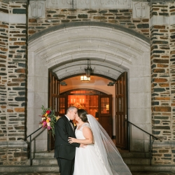 Bride and groom share kiss outside of Myers Park United Methodist Church after exchanging vows in a romantic ceremony