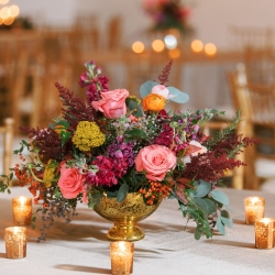 Gold compot vases full of bright pink and orange flowers created by Flower Diva are the perfect accent to an Uptown Charlotte Wedding