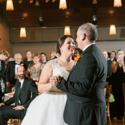 Sunshower Photography captures a bride and grooms first dance during their wedding reception coordinated by Magnificent Moments Weddings