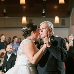 Bride shares a dance with her father to music provided by Carolina DJ Professions during her wedding at Foundation for the Carolinas