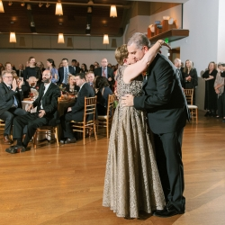 Groom shares a dance with his mother during his fall wedding coordinated by Magnificent Moments Weddings