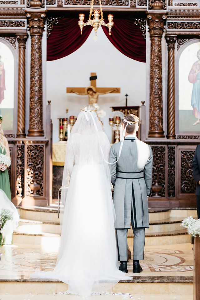 bride and groom at the Greek Orthodox church altar