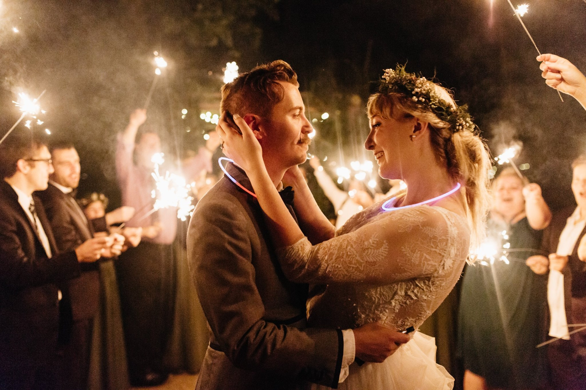 bride and groom leaving their wedding through sparklers