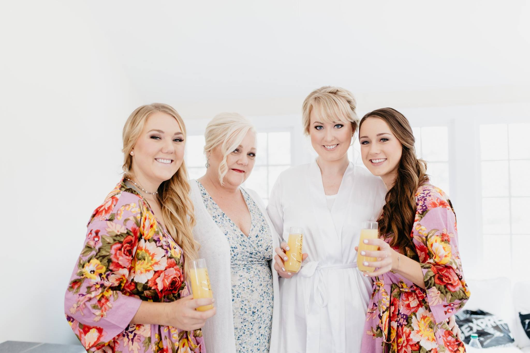 bride and bridesmaids getting ready in plum pretty sugar robes
