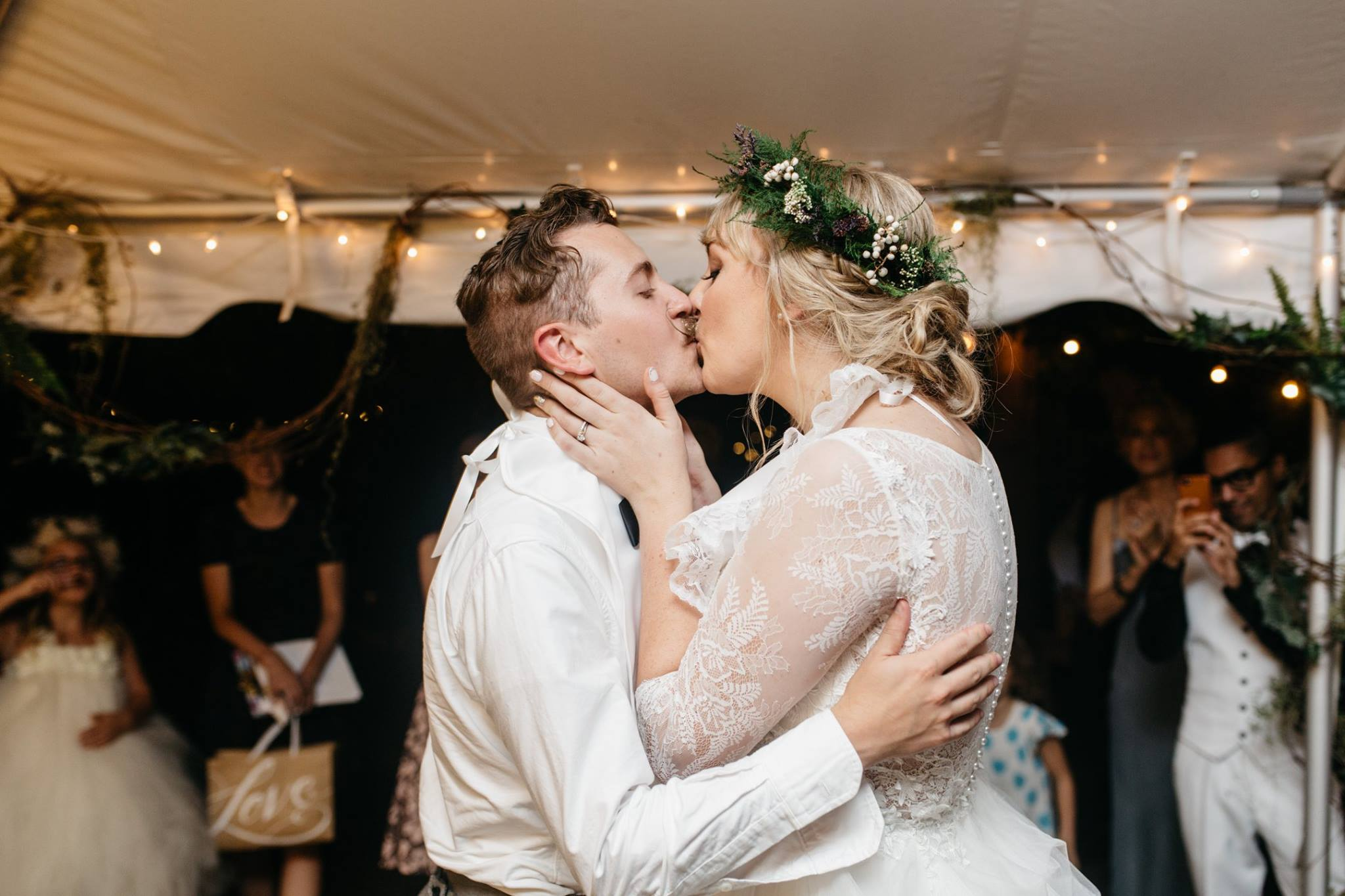 bride and groom kissing after their first dance